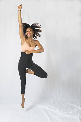 Photograph - Mercedes Jumping With Arm In Air by Dan Friend