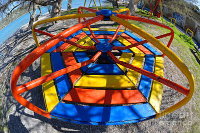 Playground Photograph - Merry-go-round In Children Playground by George Atsametakis