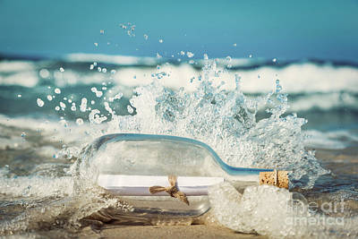 Photograph - Message In The Bottle Coming With Wave From Ocean by Michal Bednarek
