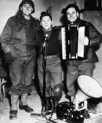 1940s Candid Photograph - Mickey Rooney Center, Entertains Troops by Everett