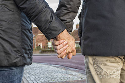 Photograph - Middle Aged Couple Holding Hands by Patricia Hofmeester