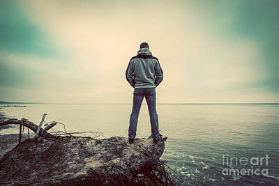 Pocket Stones Photograph - Middle-aged Man Standing On Broken Tree On Wild Beach Looking At Sea Horizon by Michal Bednarek