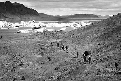 middle aged tourists walking designated pathway at Jokulsarlon glacial lagoon Iceland Art Print by Joe Fox