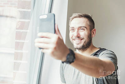Adult Photograph - Millenial Man Taking A Selfie. by Michal Bednarek