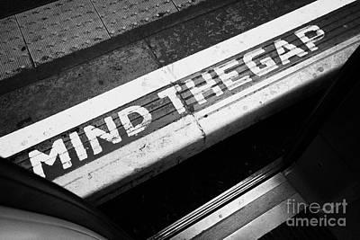 Open Mind Photograph - Mind The Gap Between Platform And Train At London Underground Station England United Kingdom Uk by Joe Fox
