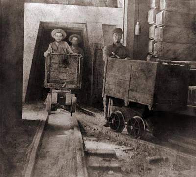 Occupational Portraits Photograph - Miners Pushing Ore Carts by Everett