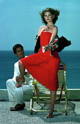 Young Man Photograph - Model Wearing A Red Dress by Guy Le Baube