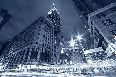 Photograph - Monochrome Blue Looking Up At The Empire State Building From Fifth Avenue At Night New York Ny by Toby McGuire