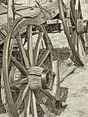 Photograph - Montana Old Wagon Wheels In Sepia by Jennie Marie Schell