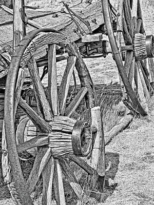 Photograph - Montana Old Wagon Wheels Monochrome by Jennie Marie Schell