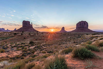 Photograph - Monument Valley Sunrise Peaking Through by John McGraw
