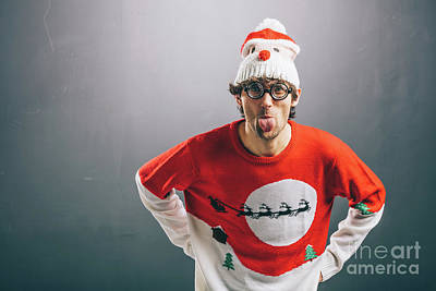 Photograph - Moody Man In Funny Christmas Clothes Sticking Out His Tongue by Michal Bednarek