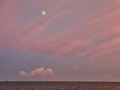 Photograph - Moon At Sunset by Charles McKelroy