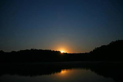 Moon Rising Over The Lake Art Print by James Jones