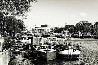 Photograph - Moored Boats At Amsterdam Canal. Monochrome by Jenny Rainbow