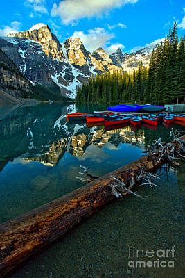 Photograph - Moraine Lake Canoes And Driftwood by Adam Jewell