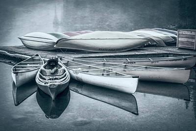 Alberta Photograph - Moraine Lake Canoes Desaturated by Joan Carroll