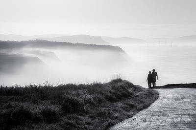 Ocean Photograph - Morning Walk With Sea Mist by Mikel Martinez de Osaba