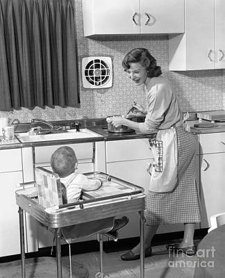 Highchair Photograph - Mother And Child In The Kitchen, C.1950s by H. Armstrong Roberts/ClassicStock