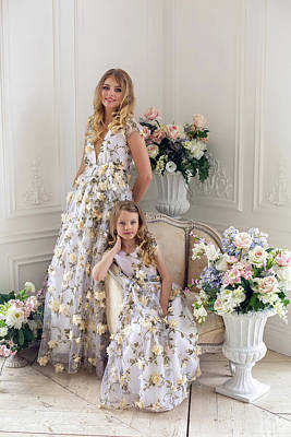 Mother And Daughter Are In The Same Floral Dresses Art Print
