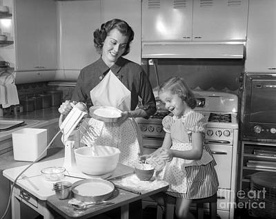 Mother And Daughter Baking A Cake Art Print