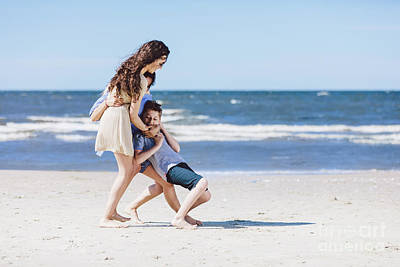 Photograph - Mother And Daughter Playing With Little Brother By The Sea. by Michal Bednarek