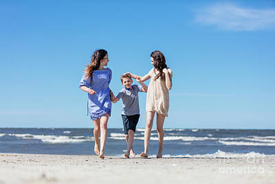 Photograph - Mother And Her Children Having A Walk By The Sea. by Michal Bednarek
