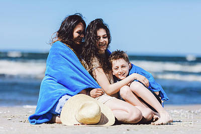 Photograph - Mother And Her Children Wrapped In A Blanket By The Sea. by Michal Bednarek