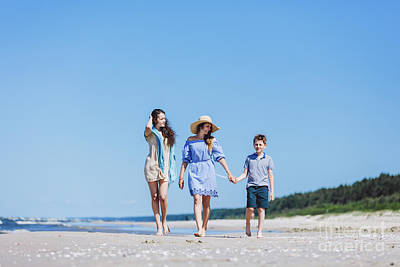 Photograph - Mother And Her Two Children Walking On The Beach by Michal Bednarek