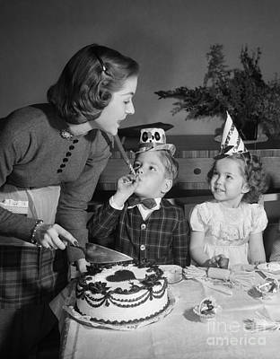 Mother Cutting Birthday Cake Art Print by Debrocke/ClassicStock