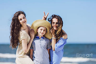Photograph - Mother Daughter And A Boy In A Straw Hat Messing Around. by Michal Bednarek