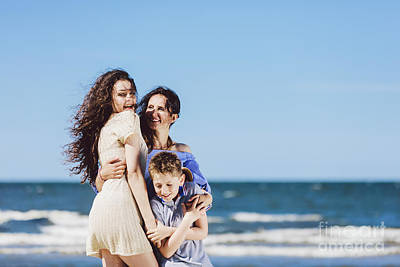 Photograph - Mother, Daughter And Son Hugging On The Beach. by Michal Bednarek