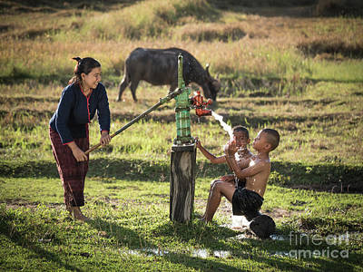 Art Print featuring the photograph Mother Her Sons Shower Outdoor From Groundwater Pump. by Tosporn Preede