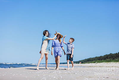 Photograph - Mother With Children Walking By The Sea by Michal Bednarek