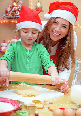 Photograph - Mother With Son Doing Christmas Cookies by Anna Om