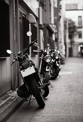 Focus On Foreground Photograph - Motorbikes Parked On Street In Tokyo, Japan by photo by Jason Weddington