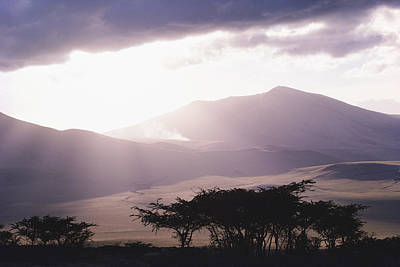 Cosmic And Atmospheric Phenomena Photograph - Mountains And Smoke, Ngorongoro Crater by Skip Brown