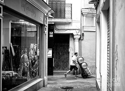 Photograph - Moving Kegs In Seville by John Rizzuto