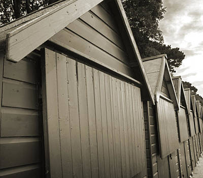 Mudeford Huts Print by Andy Smy