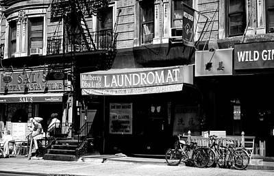 Photograph - Mulberry Street Laundromat by John Rizzuto