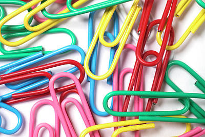On Paper Photograph - Multi Colored Paper Clips Isolated On White by Donald Erickson