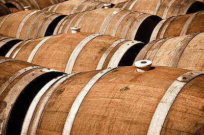 Photograph - Multiple Wine Barrels In A Cellar by Brandon Bourdages