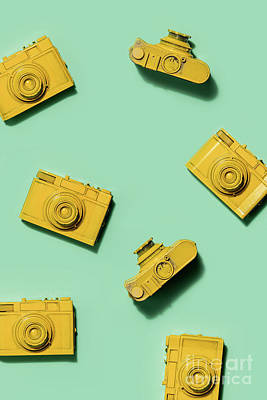 Photograph - Multiple Yellow Cameras On Green Background. by Michal Bednarek