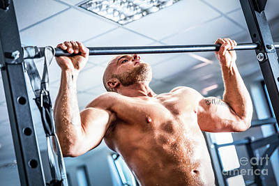 Chin Up Photograph - Muscular Strong Man Training At A Gym. by Michal Bednarek