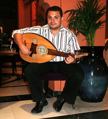 Photograph - Musician In A Cairo Restaurant by Laurel Talabere