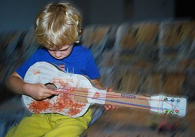 Music Royalty-Free and Rights-Managed Images - My Weeping Guitar Catus 1 No. 2 - Boy Playing With  A Homemade Toy Guitar L B  by Gert J Rheeders