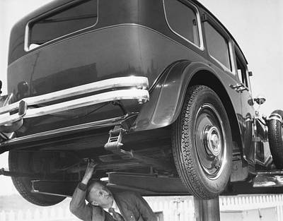Checking Photograph - Mystery Front Wheel Drive Car by Underwood Archives