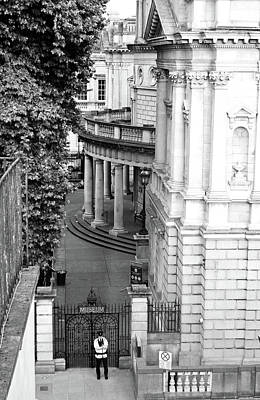 Photograph - National Museum Of Archeology Side Entrance Gate And Garda Dublin Ireland Black And White by Shawn O'Brien