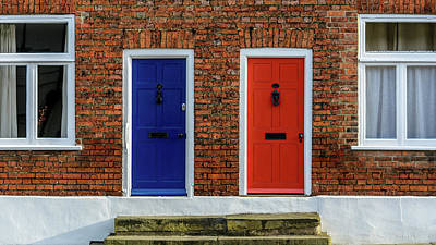 Photograph - Neighbouring Terraced Houses With One Blue And One Red Front Door by Jacek Wojnarowski