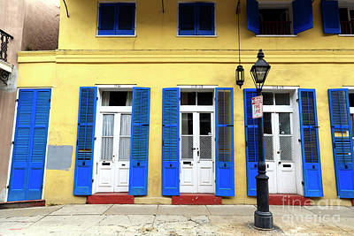 Photograph - New Orleans Yellow Row House by John Rizzuto